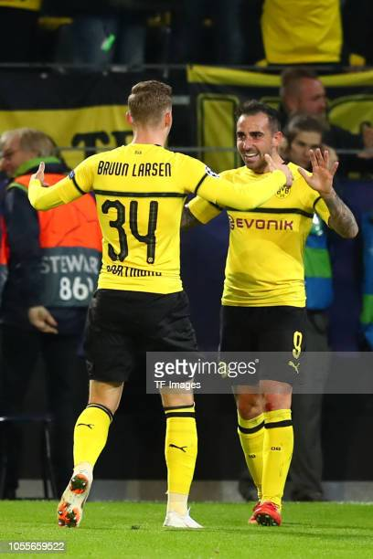 Paco Alcacer of Borussia Dortmund celebrates after scoring his team`s second goal with Jacob Bruun Larsen of Borussia Dortmund during the Group A...