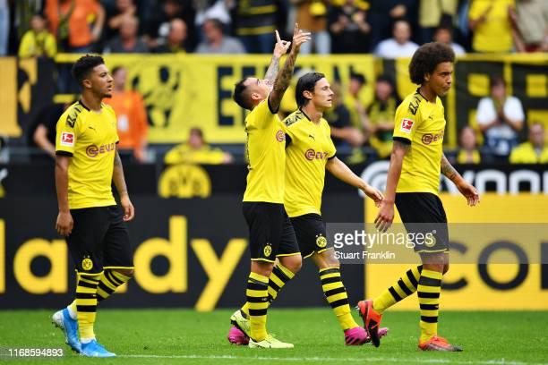 Paco Alcacer of Borussia Dortmund celebrates scoring his sides fourth goal during the Bundesliga match between Borussia Dortmund and FC Augsburg at...