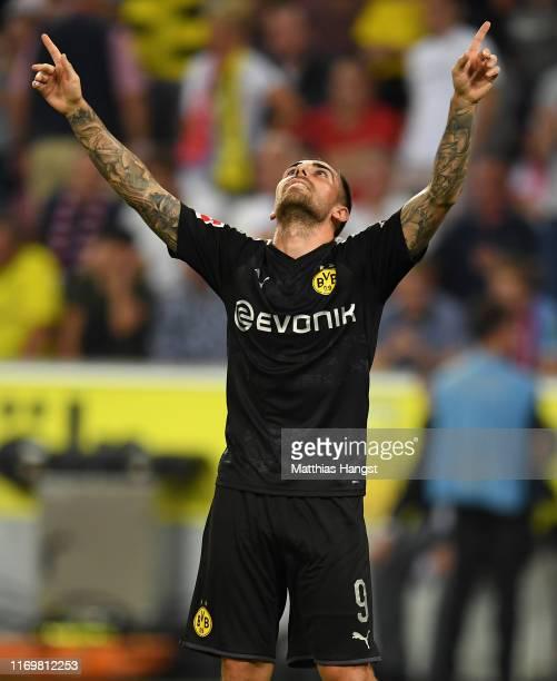 Paco Alcacer of Borussia Dortmund celebrates scoring his side's third goal during the Bundesliga match between 1 FC Koeln and Borussia Dortmund at...