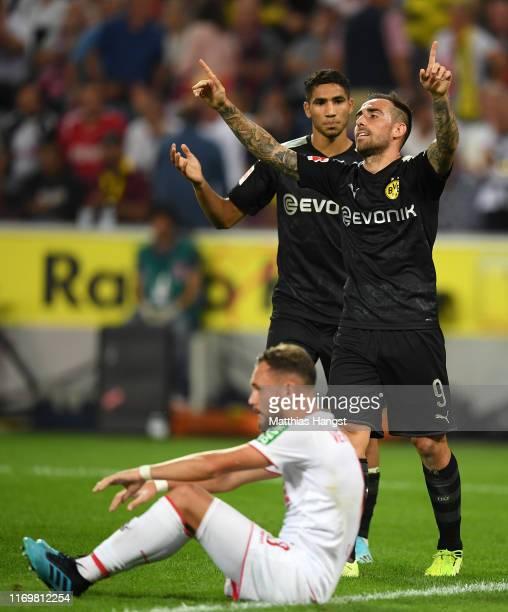 Paco Alcacer of Borussia Dortmund celebrates scoring his side's third goal during the Bundesliga match between 1. FC Koeln and Borussia Dortmund at...