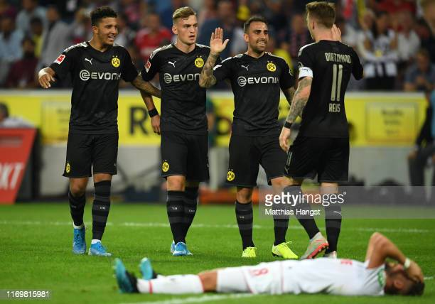 Paco Alcacer of Borussia Dortmund celebrates with his team mates after scoring his side's third goal during the Bundesliga match between 1. FC Koeln...