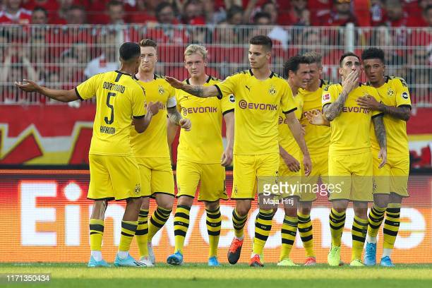 Paco Alcacer of Borussia Dortmund celebrates with his team mates after scoring his team's first goal during the Bundesliga match between 1. FC Union...