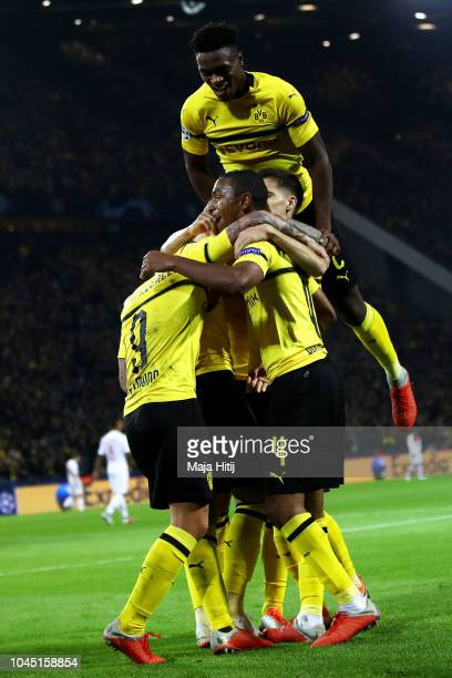 Paco Alcacer of Borussia Dortmund celebrates with team mates after scoring his team's second goal during the Group A match of the UEFA Champions...