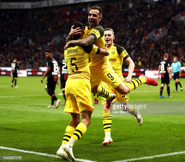 Paco Alcacer of Borussia Dortmund celebrates with teammates after scoring his team's third goal during the Bundesliga match between Bayer 04...