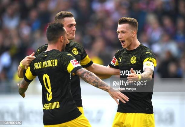 Paco Alcacer of Borussia Dortmund celebrates with teammates after scoring his team's third goal during the Bundesliga match between VfB Stuttgart and...