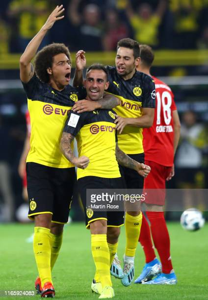 Paco Alcacer of Borussia Dortmund celebrates with teammates after scoring his team's first goal during the DFL Supercup 2019 match between Borussia...