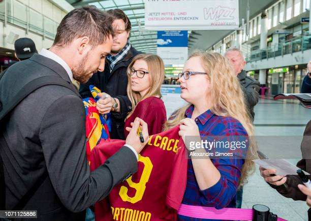 Paco Alcacer of Borussia Dortmund is giving autographs at the airport prior to the flight to Nice for the UEFA Champions League Group A match between...