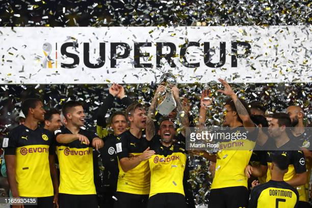 Paco Alcacer of Borussia Dortmund lifts the DFL Supercup Trophy following his team's victory in the DFL Supercup 2019 match between Borussia Dortmund...