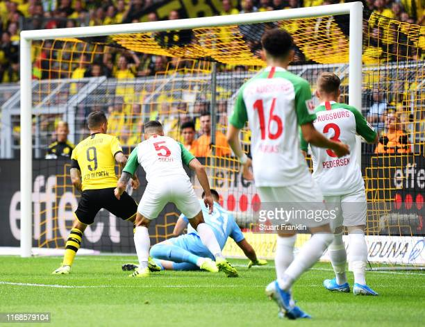 Paco Alcacer of Borussia Dortmund scores his sides first goal during the Bundesliga match between Borussia Dortmund and FC Augsburg at Signal Iduna...