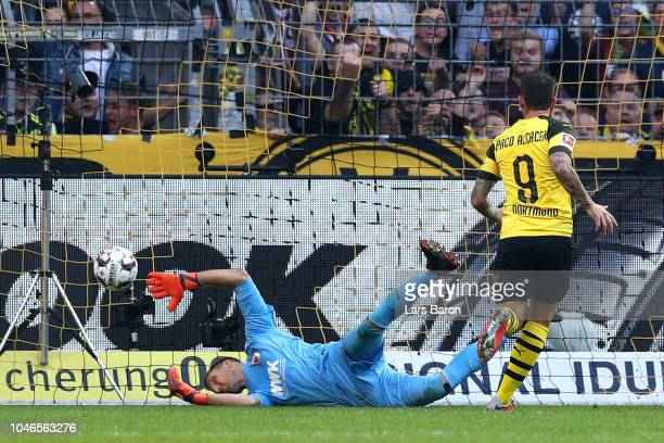 Paco Alcacer of Borussia Dortmund scores his team's first goal during the Bundesliga match between Borussia Dortmund and FC Augsburg at Signal Iduna...