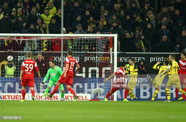 Paco Alcacer of Borussia Dortmund scores his team's first goal during the Bundesliga match between Fortuna Duesseldorf and Borussia Dortmund at...