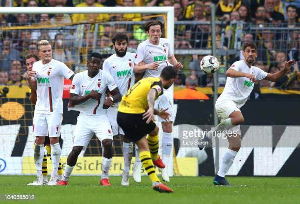 Paco Alcacer of Borussia Dortmund scores his team's fourth goal during the Bundesliga match between Borussia Dortmund and FC Augsburg at Signal Iduna...