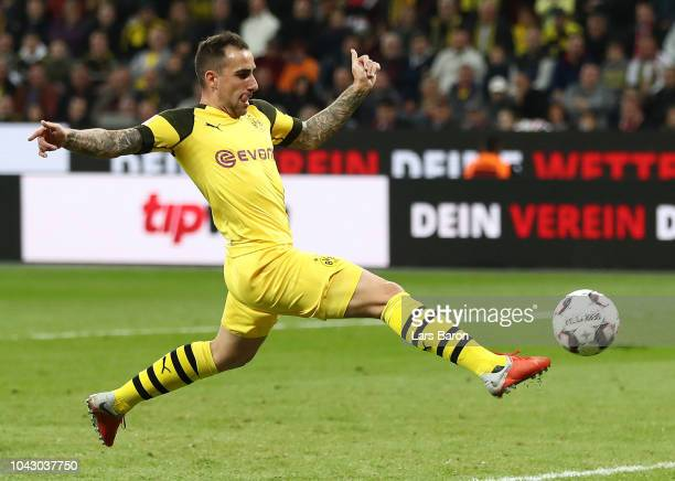 Paco Alcacer of Borussia Dortmund scores his team's third goal during the Bundesliga match between Bayer 04 Leverkusen and Borussia Dortmund at...