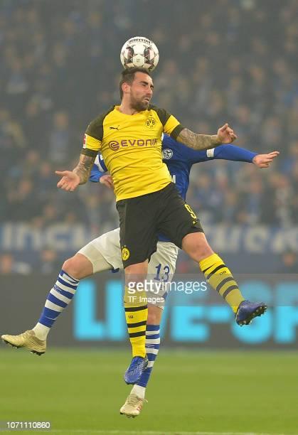 Paco Alcacer of Dortmund and Sebastian Rudy of Schalke battle for the ball during the Bundesliga match between FC Schalke 04 and Borussia Dortmund at...