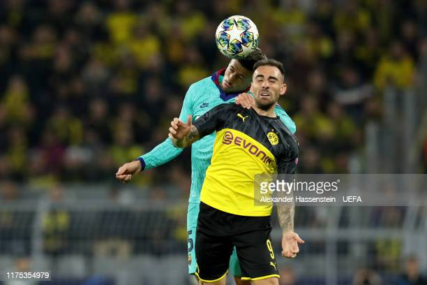 Paco Alcacer of Dortmund battles for the ball with Sergio Busquets of FC Barcelona during the UEFA Champions League group F match between Borussia...