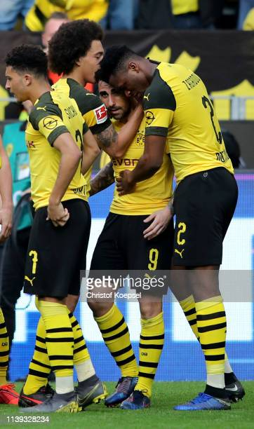 Paco Alcacer of Dortmund celebrates the first goal with Axel Witsel and Dan-Axel Zagadou of Dortmund during the Bundesliga match between Borussia...