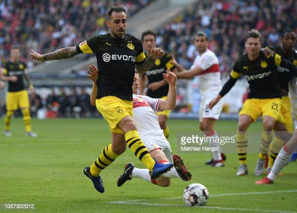 Paco Alcacer of Dortmund is challenged by Santiago Ascacibar of Stuttgart during the Bundesliga match between VfB Stuttgart and Borussia Dortmund at...