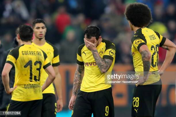 Paco Alcacer of Dortmund reacts with his team mate Axel Witsel after during the Bundesliga match between FC Augsburg and Borussia Dortmund at...