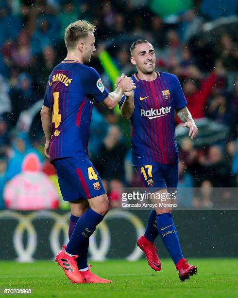 Paco Alcacer of FC Barcelona celebrates scoring their opening goal with teammate Ivan Rakitic during the La Liga match between FC Barcelona and...