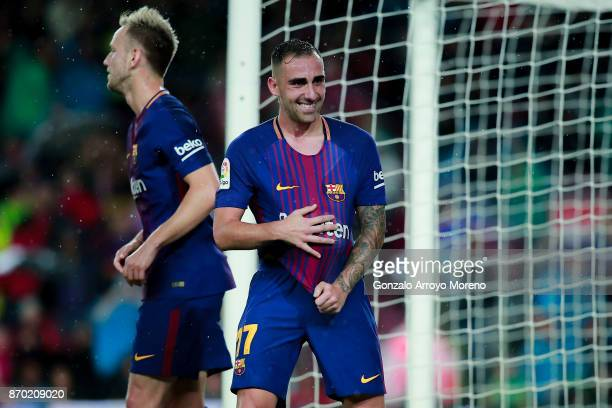 Paco Alcacer of FC Barcelona celebrates scoring their opening goal during the La Liga match between FC Barcelona and Sevilla FC at Camp Nou stadium...
