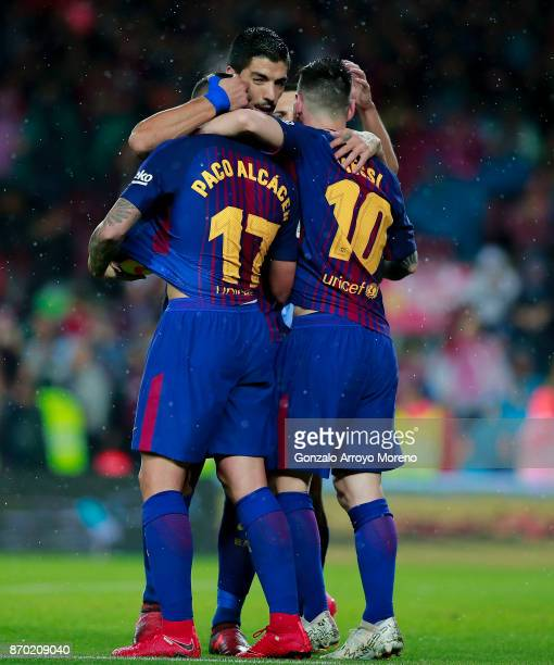Paco Alcacer of FC Barcelona celebrates scoring their opening goal with teammates Luis Suarez and Lionel Messi during the La Liga match between FC...