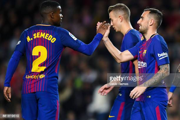 Paco Alcacer of FC Barcelona celebrates with his team mate Nelson Semedo after scoring his team's first goal during the Copa del Rey round of 32...