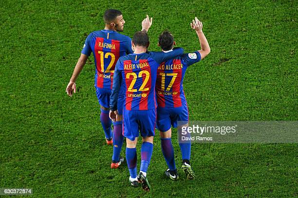 Paco Alcacer of FC Barcelona celebrates with his team mates Aleix Vidal and Rafinha Alcantara after scoring his team's fifth goal during the Copa del...