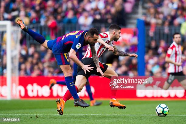Paco Alcacer of FC Barcelona fights for the ball with Unai Nunez of Athletic Club during the La Liga match between Barcelona and Athletic Club at...