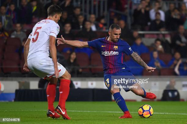Paco Alcacer of FC Barcelona in action against Clement Lenglet of Sevilla FC during the Spanish league football match between FC Barcelona and...