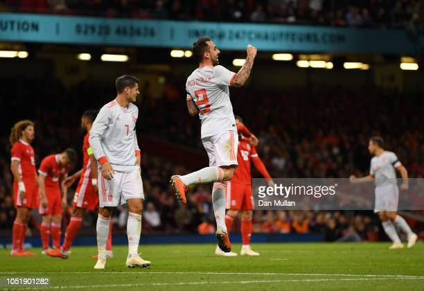 Paco Alcacer of Spain celebrates as he scores his team's third goal during the International Friendly match between Wales and Spain on October 11...