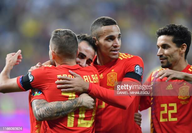 Paco Alcacer of Spain celebrates with his teammates after he scored 2-0 goal during the Euro 2020 football qualification match between Romania and...