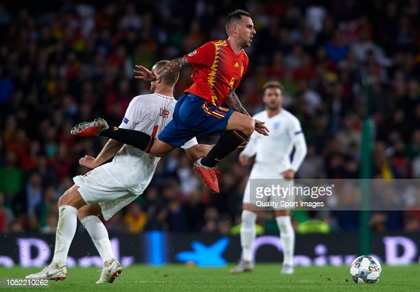 Paco Alcacer of Spain is tackled by Eric Dier of England during the UEFA Nations League A group four match between Spain and England at Estadio...