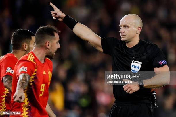 Paco Alcacer of Spain referee Szymon Marciniak during the UEFA Nations league match between Spain v England at the Estadio Benito Villamarin on...