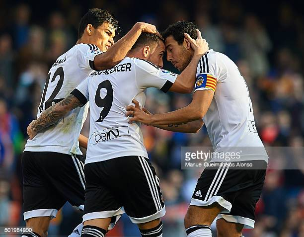 Paco Alcacer of Valencia celebrates scoring his team's first goal with his teammates Danilo Barbosa and Daniel Parejo during the La Liga match...