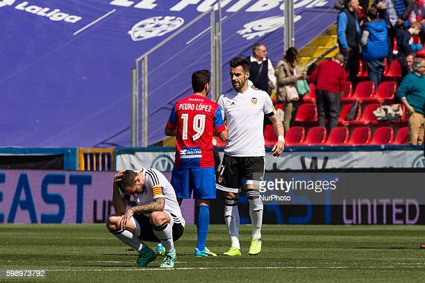 Paco Alcacer of Valencia CF 19 Pedro Lopez Munoz of Levante ud and 07 Alvaro Negredo of Valencia CF during la liga match between Levante UD and...