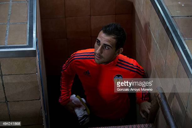 Paco Alcacer of Valencia CF access to the bench from the dressing room tunnel prior to start the La Liga amtch between Club Atletico de Madrid and...
