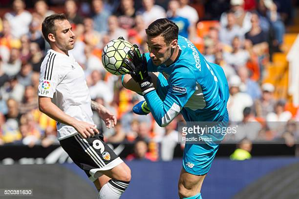 Paco Alcacer of Valencia CF and 01 Sergio Rico Gonzalez of Sevilla CF during La Liga match between Valencia CF and Sevilla CF at Mestalla Stadium...