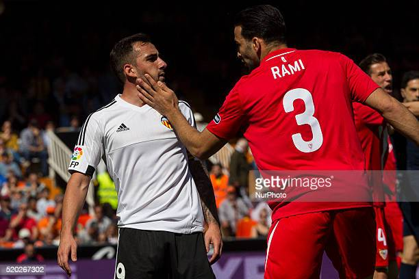 09 Paco Alcacer of Valencia CF and 03 Adil Rami of Sevilla CF during La Liga match between Valencia CF and Sevilla CF at Mestalla Stadium in Valencia...