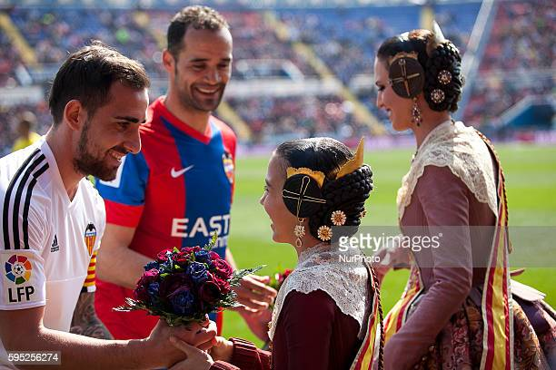 Paco Alcacer of Valencia CF and 12 Juan Francisco Garcia Juanfran of Levante UD with falleras mayores of valencia during la liga match between...