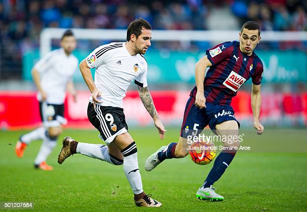 Paco Alcacer of Valencia CF duels for the ball with Gonzalo Escalante of SD Eibar during the La Liga match between SD Eibar and Valencia CF at Ipurua...