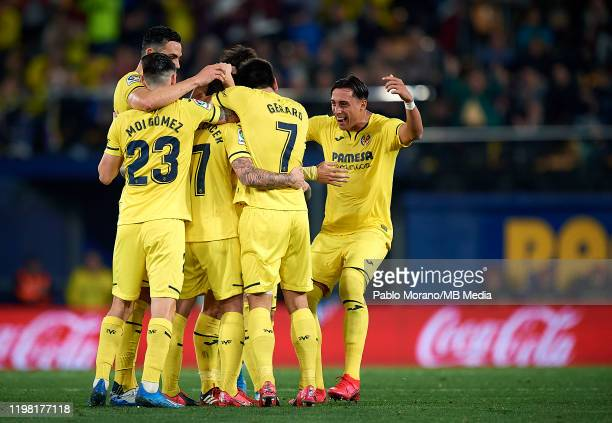 Paco Alcacer of Villarreal celebrates with his teammates after scoring a goal during the Liga match between Villarreal CF and CA Osasuna at Estadio...