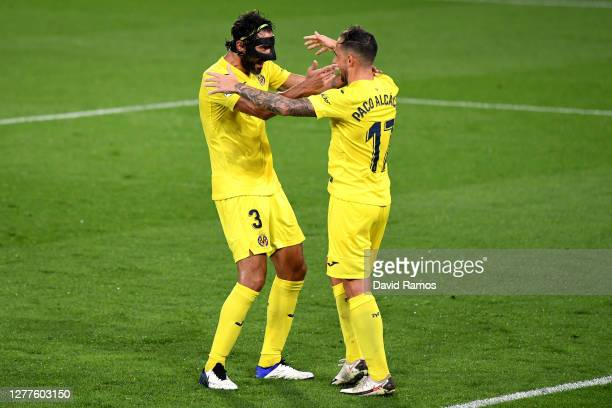 Paco Alcacer of Villarreal celebrates with Raul Albiol of Villarreal after scoring his team's third goalduring the La Liga Santander match between...