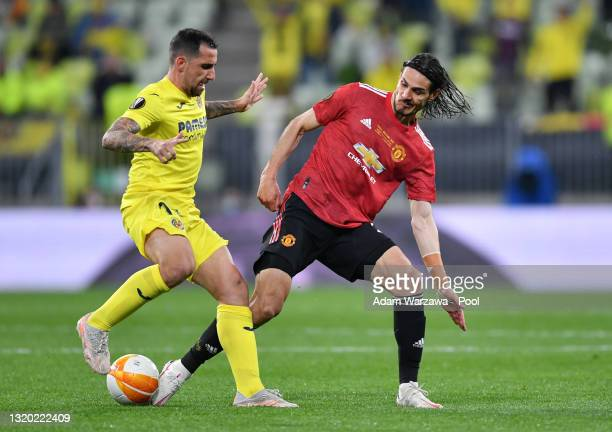 Paco Alcacer of Villarreal CF battles for possession with Edinson Cavani of Manchester United during the UEFA Europa League Final between Villarreal...
