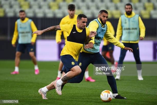 Paco Alcacer of Villarreal CF battles for possession with team mate Etienne Capoue during the Villarreal CF Training Session ahead of the UEFA Europa...