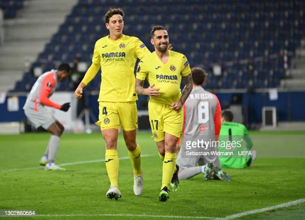 Paco Alcacer of Villarreal CF celebrates after scoring their sides first goal with team mate Pau Torres during the UEFA Europa League Round of 32...