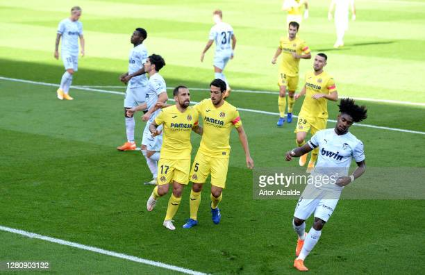 Paco Alcacer of Villarreal CF celebrates with teammate Dani Parejo after scoring his team's first goal during the La Liga Santander match between...
