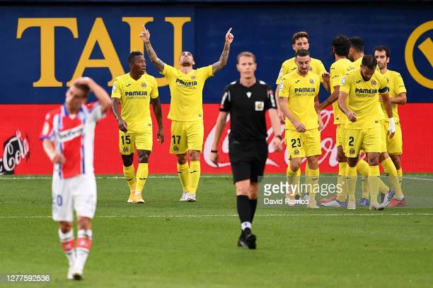 Paco Alcacer of Villarreal CF celebrates with teammates after scoring his sides first goal during the La Liga Santander match between Villarreal CF...