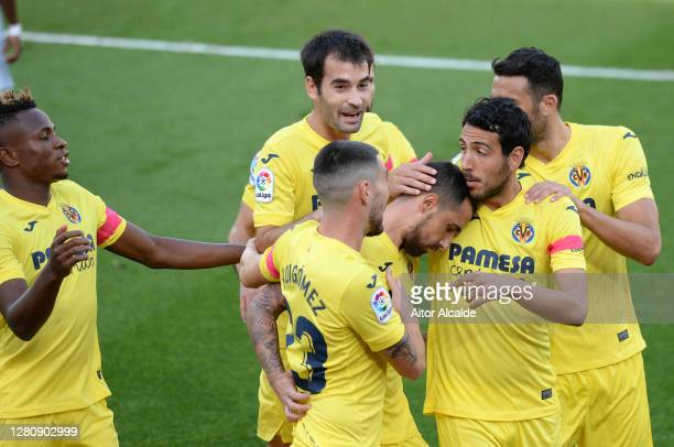 Paco Alcacer of Villarreal CF celebrates with teammates after scoring his team's first goal during the La Liga Santander match between Villarreal CF...