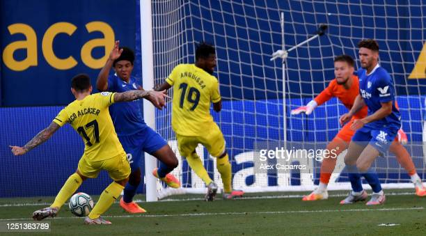 Paco Alcacer of Villarreal scores the opening goal during the Liga match between Villarreal CF and Sevilla FC at Estadio de la Ceramica on June 22,...