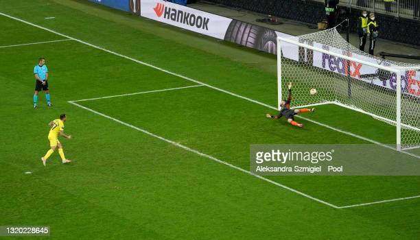 Paco Alcacer of Villarreal scores their team's third penalty in the penalty shoot out past David De Gea of Manchester United during the UEFA Europa...